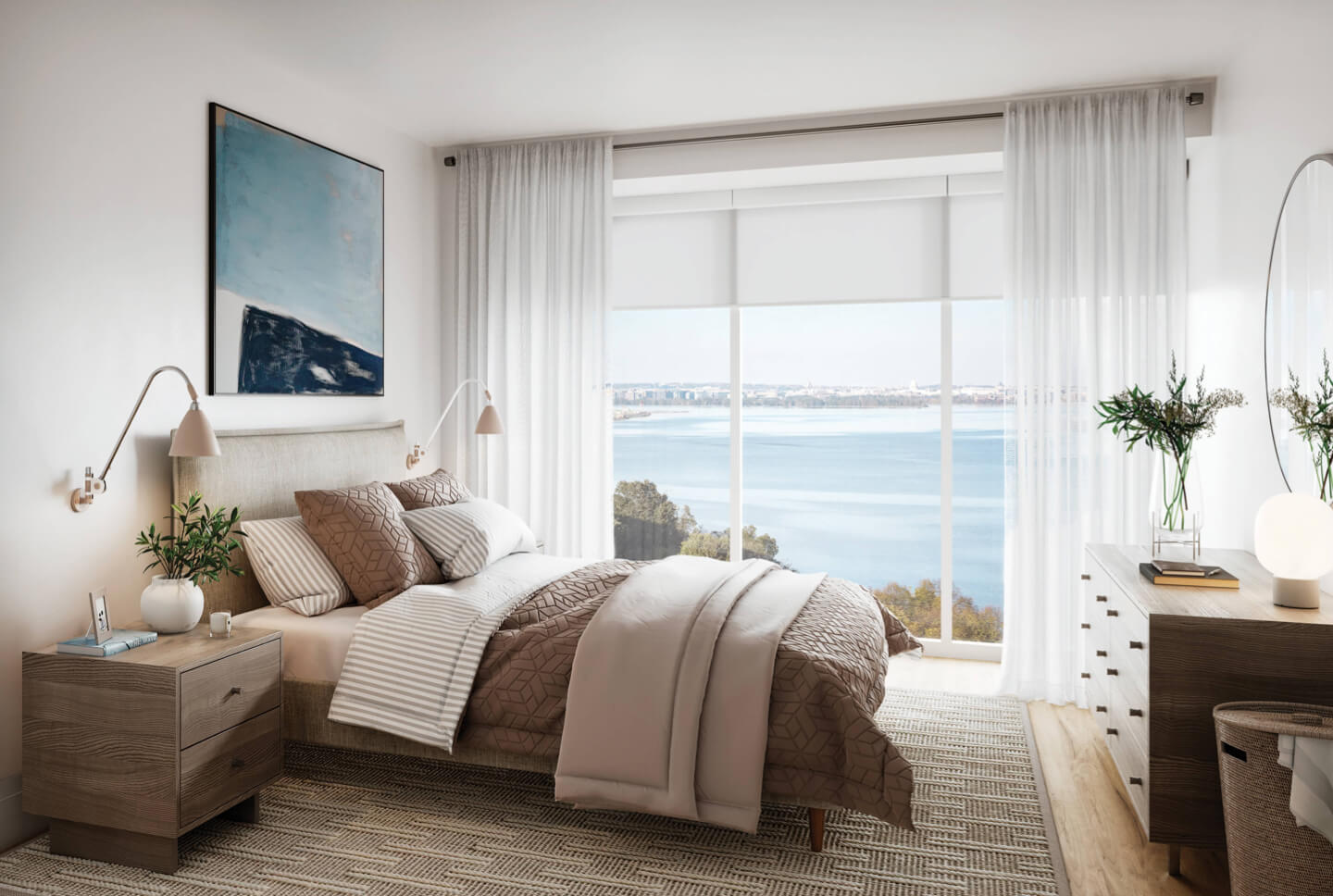 Condo residence bedroom with bed in front of large window overlooking waterfront
