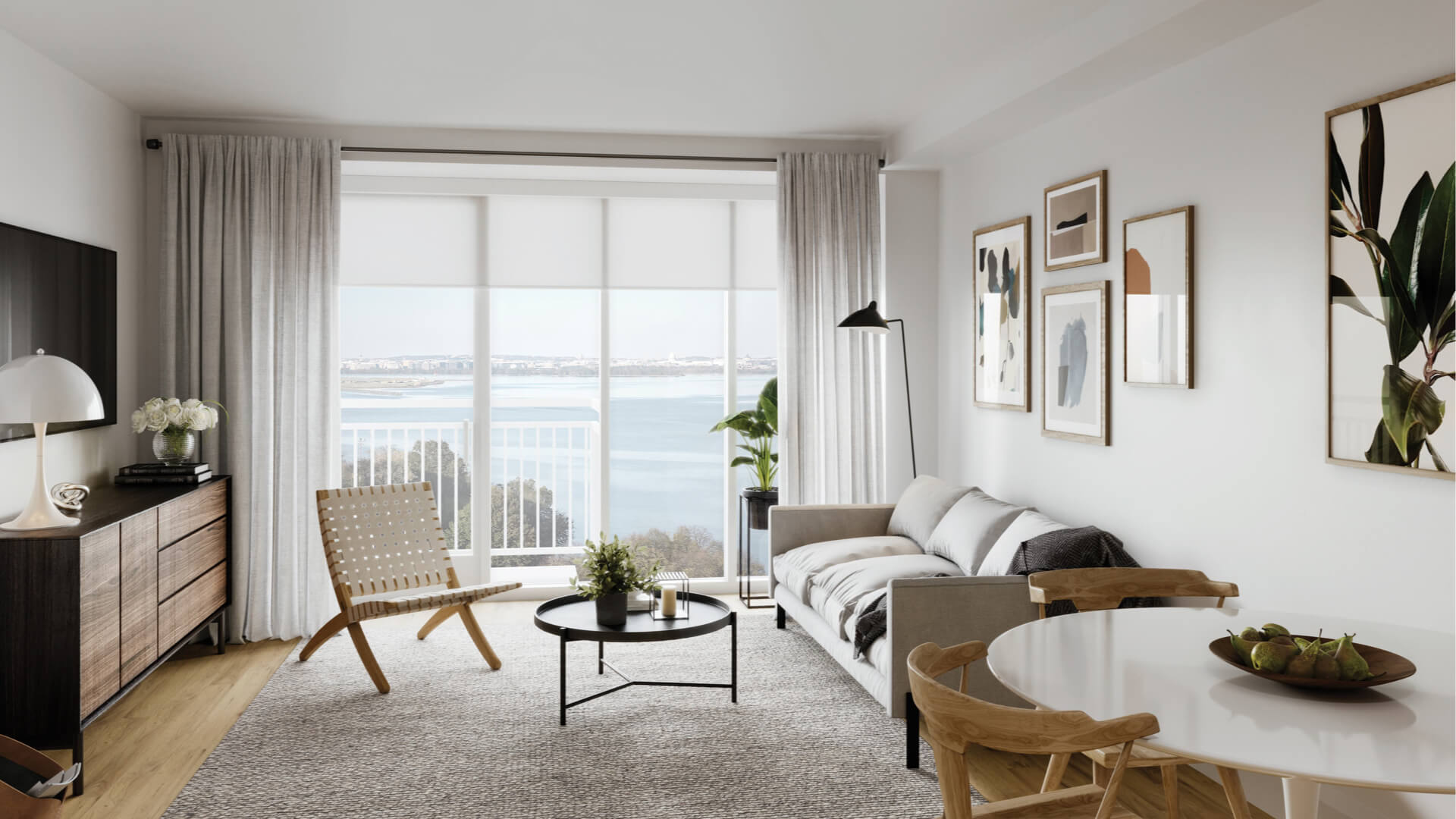 Condo residence at Venue with white walls and a view of the riverfront